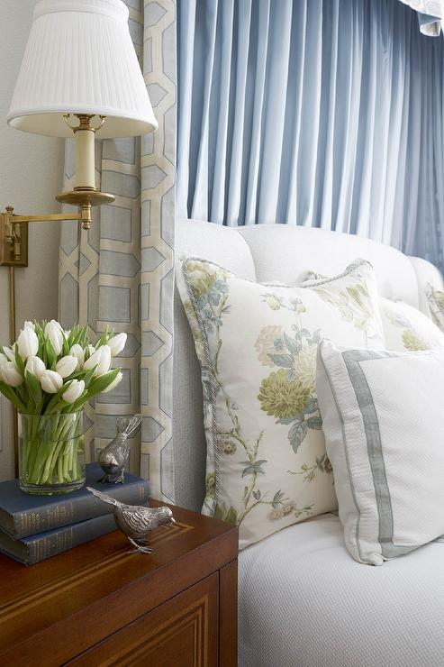 blue drapery panels behind light gray headboard - traditional