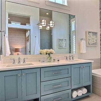 'Blue Shaker Dual Vanity' from the web at 'https://cdn.decorpad.com/photos/2017/06/29/m_blue-bath-vanity-cabinets.jpg'