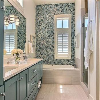 'Blue Glass Herringbone Shower Tiles' from the web at 'https://cdn.decorpad.com/photos/2017/06/29/m_blue-glass-shower-tiles.jpg'