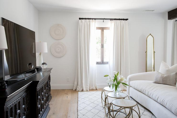 Spanish Style Bedroom Features A Beautifully Designed Sitting Area  Furnished With A Gold Moorish Floor Mirror Placed Beside A Window Dressed  In White ...