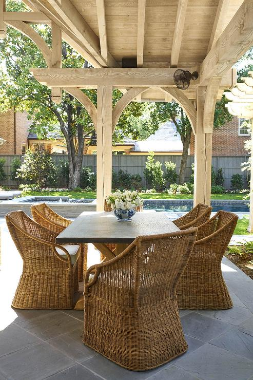 Salvaged Wood And Zinc Dining Table With Wicker Chairs