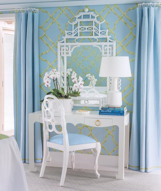 Meg Braff Interiors designs a blue chinoiserie bedroom with a bamboo pagoda mirror with Meg Braff Brighten Your Pavilion Wallpaper.
