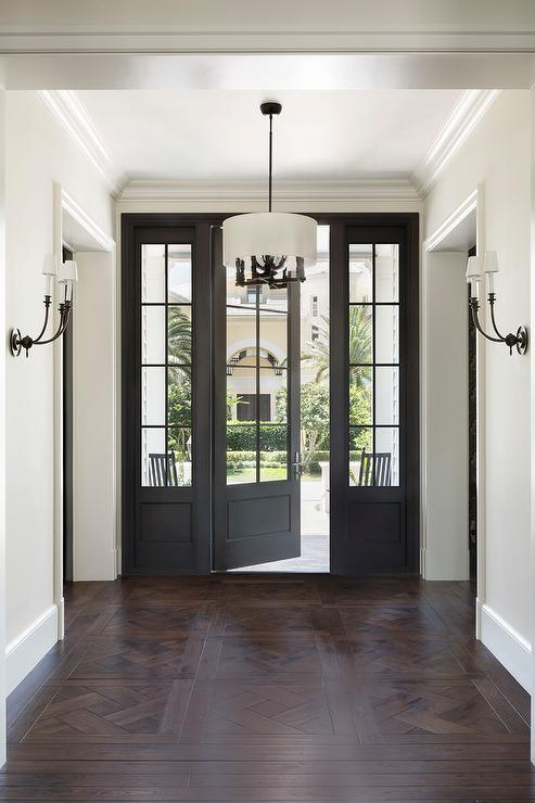 Parquet Wood Floors With Black Door Transitional Entrance Foyer