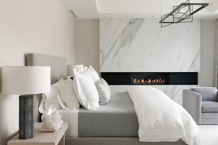Heather Gray Bed with Modern Marble Fireplace - Modern - Bedroom
