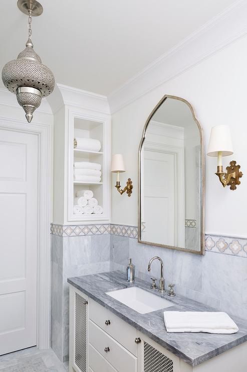 White And Gray Moroccan Style Bath With Gold Accents