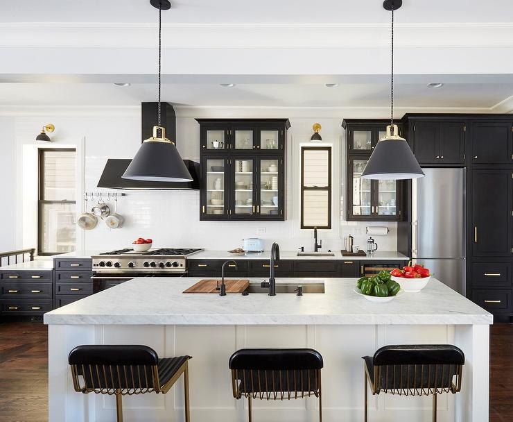 Black Glass Front Kitchen Cabinets With Brass Pulls Transitional