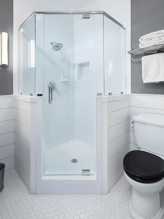 large corner shower enclosures. Lovely gray and white bathroom boasts a corner shower fitted with shiplap  glass enclosure polished nickel kit fixed to large hex Interior design inspiration photos by Willow Homes