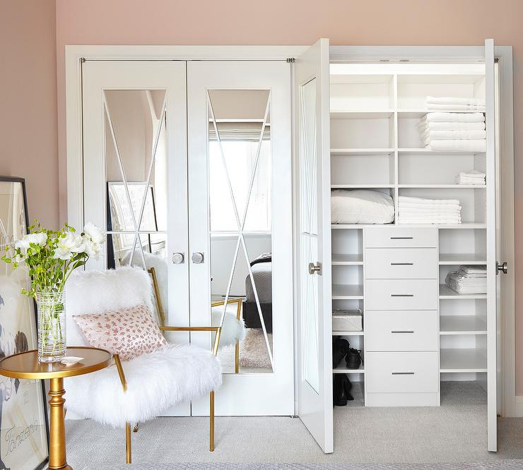 mirrored bi fold closet doors are accented with x trim adding a chic feature to a girls bedroom closet - Bedroom Closet Doors