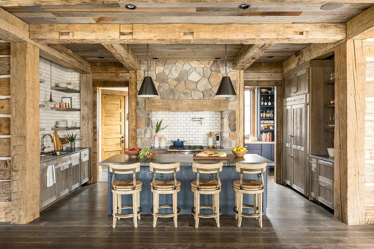 Rustic Cabin Kitchen With Wood Pillars And Beams Country