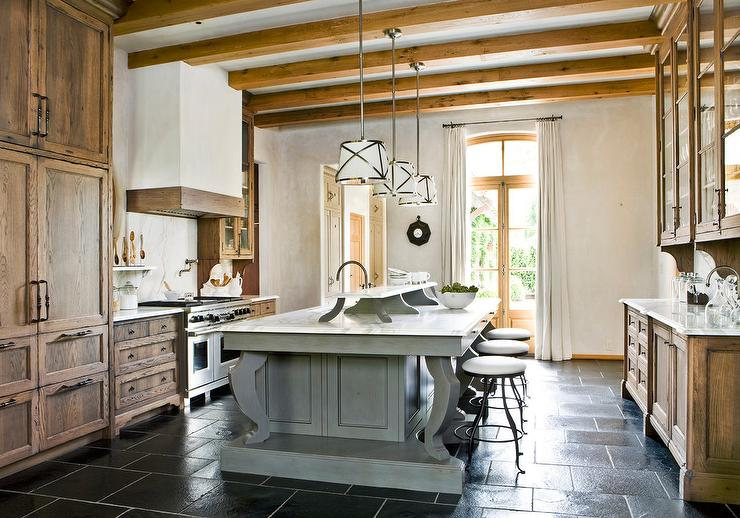 Gray Kitchen Island With Black Staggered Floor Tiles Transitional