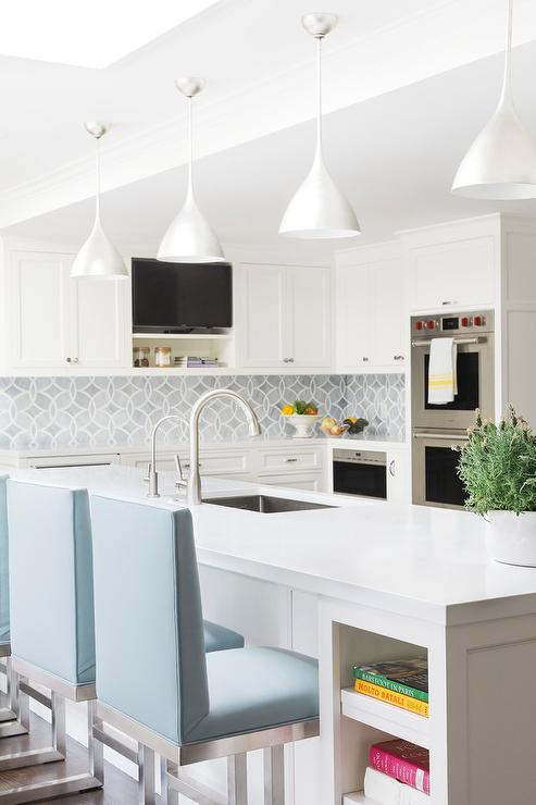 Sky Blue Upholstered Counter Stools At Kitchen Peninsula
