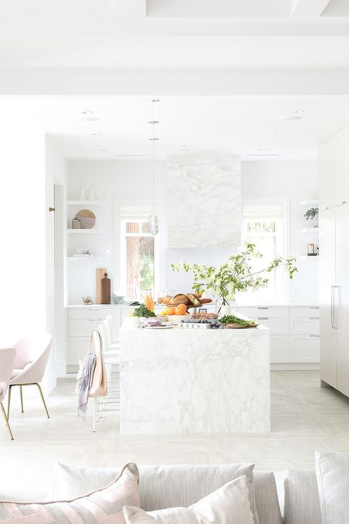 White Marble Clad Vent Hood With White Herringbone Tiles
