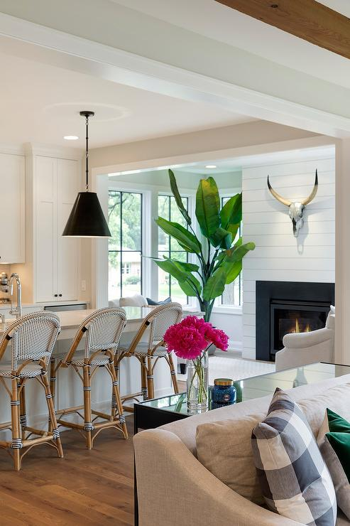 A Black Sofa Table Sits Behind A Light Gray Slipcovered Sofa Accented With  Gray Plaid And Emerald Green Velvet Pillows.