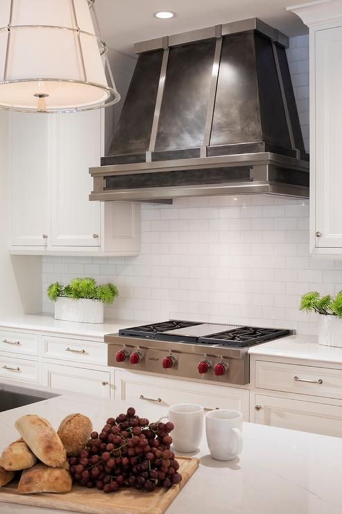 Dark Steel Kitchen Vent Hood With White Tiles Transitional