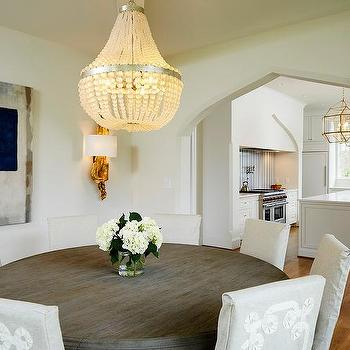 White Beaded Chandelier With Round Wood Dining Table