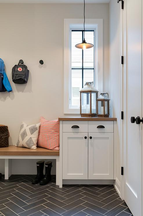 White Mudroom Bench With Black Herringbone Tiles