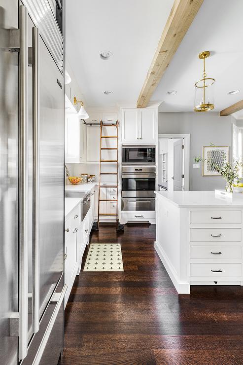 Ladder On Rails On White Kitchen Cabinets