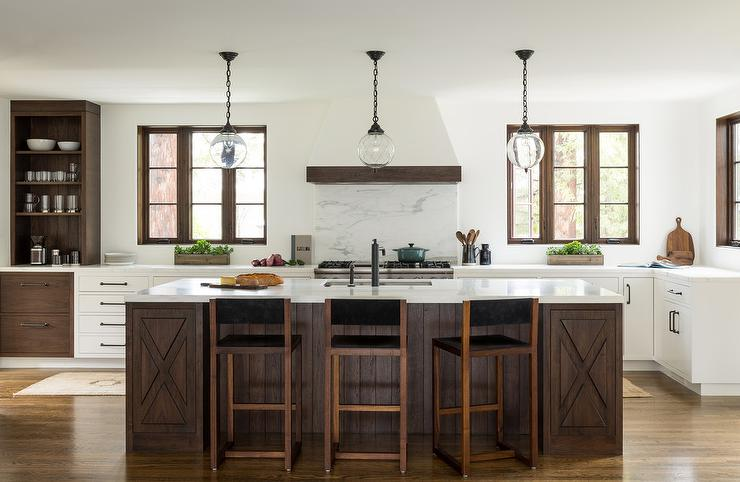 Dark wood mediterranean style island with 3 glass light for Mediterranean style kitchen photos