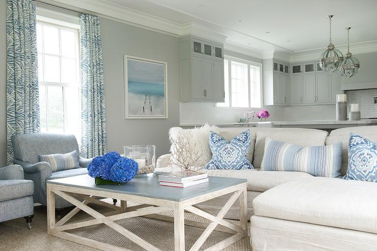 Off White Linen Slipcovered Sectional With Blue Pillows