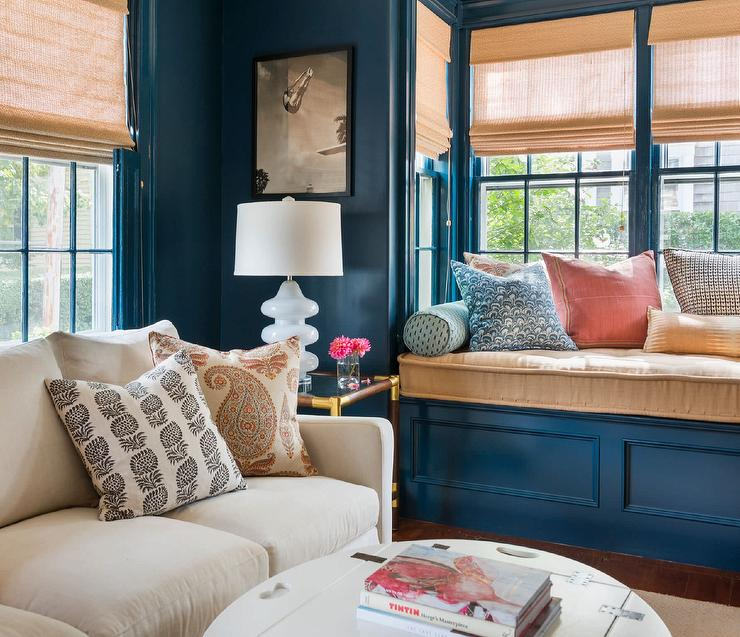 Wonderful Blue Family Room Is Fitted With A Blue Wainscot Built In Window  Seat Bench Topped With A Beige Cushion Complementing Beige Roman Shades.