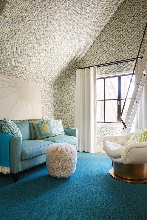 Light Blue Sofa With Blue Diamond Pattern Rug