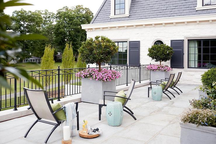 Sleek patio chairs with light blue stool tables for Elegant patios