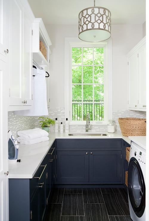 navy blue laundry room cabinets with black wood like floor tiles transitional laundry room. Black Bedroom Furniture Sets. Home Design Ideas