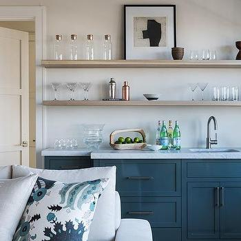 Blue Wet Bar With Gray Floating Shelves