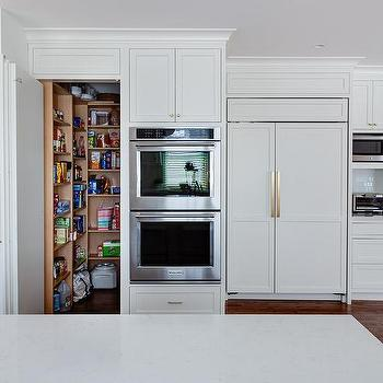 Exceptional Walk In Pantry Concealed Behind Cabinet Doors