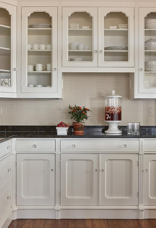 Off White Kitchen Cupboards polished black marble countertops with off white cabinets