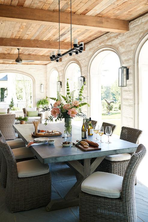 Zinc Top Outdoor Dining Table With Wicker Slipper Chairs