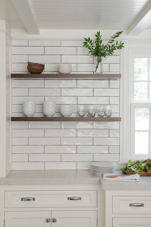 Walnut Floating Shelves with White Kitchen Cabinets