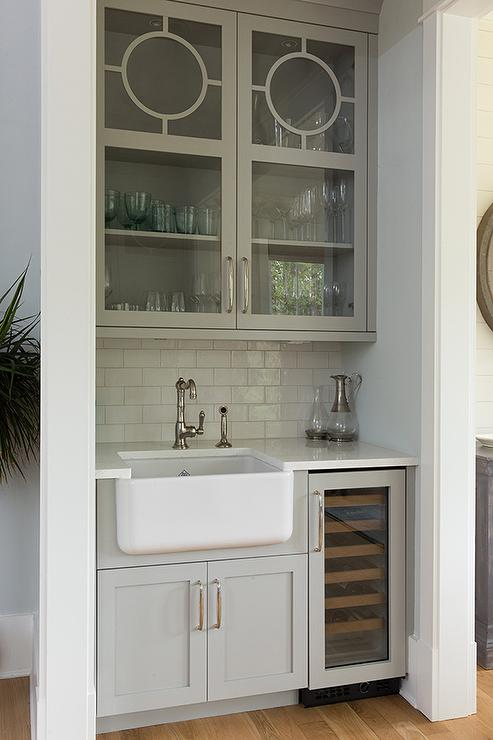 Gray glass front wet bar cabinets over farmhouse sink transitional kitchen - Wet bar cabinets ...