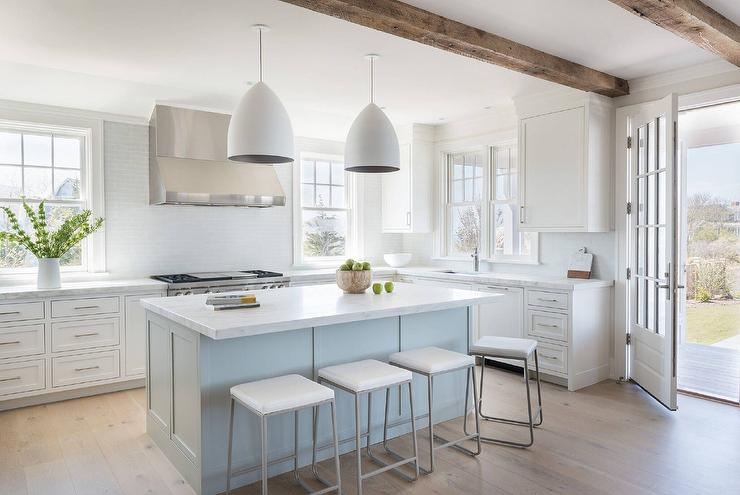 Merveilleux Lovely Blue And White Kitchen Boasts Sleek Bar Stools Placed At A Light Blue  Center Island Topped With A Honed White Marble Countertop Lit By Two White  Egg ...
