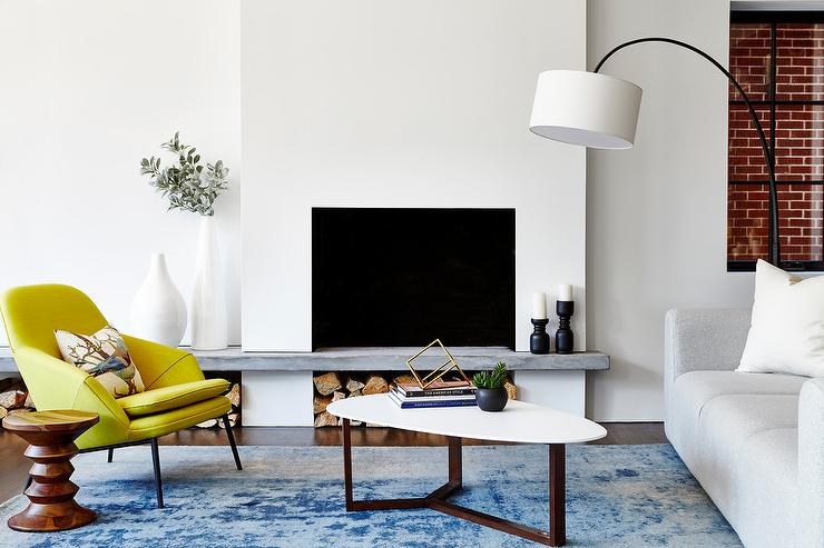 yellow chairs living room. Canary Yellow Chair with Blue Overdyed Rug  Contemporary Living
