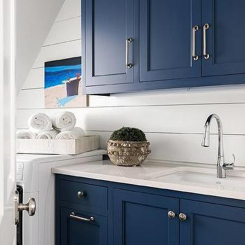 Blue Shaker Laundry Cabinets With Ivory Quartz Countertops