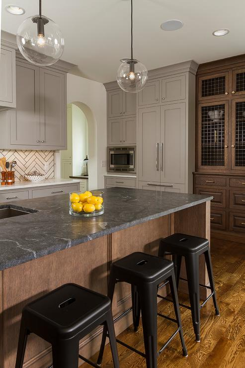 Chocolate Brown Center Island with Soapstone Countertop ... on solid surface countertops, quartz countertops, black countertops, marble countertops, agate countertops, corian countertops, granite countertops, copper countertops, metal countertops, stone countertops, silestone countertops, hanstone countertops, bamboo countertops, slate countertops, paperstone countertops, kitchen countertops, obsidian countertops, gray limestone countertops, butcher block countertops, concrete countertops,
