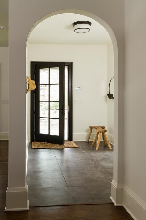 Black Glass Panel Front Door With Concrete Gray Tiles