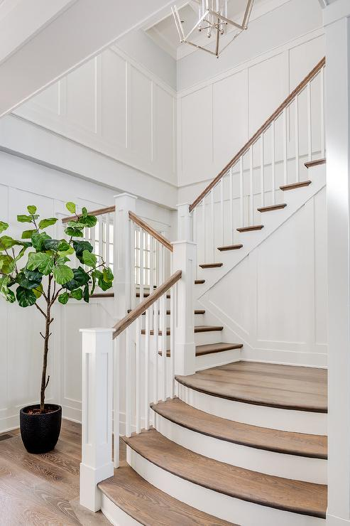 Lined With A Board And Batten Trim, This Gorgeous White Staircase Is  Accented With Curved Stained Oak Treads And White Spindles Finished With A  Stained Oak ...