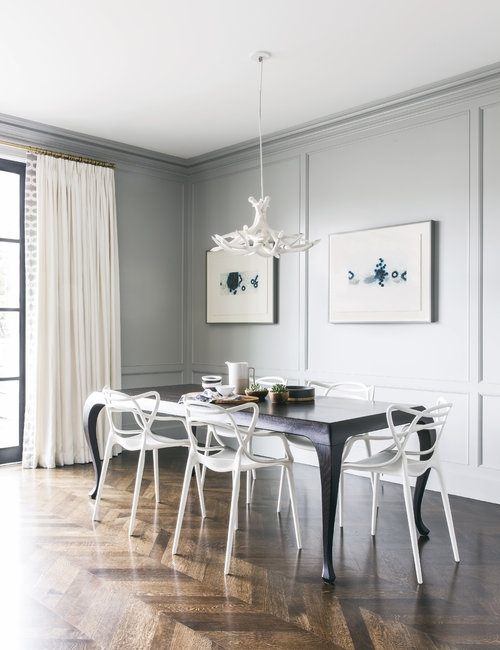 White Kartell Masters Chairs With Black Dining Table