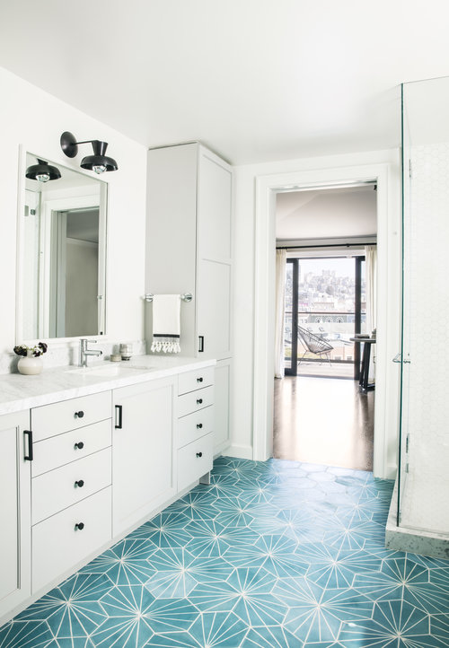 eye catching turquoise blue cement floor tiles accent a light gray dual bath vanity fitted with oil rubbed bronze hardware and a white marble countertop - Turquoise Floor Tile
