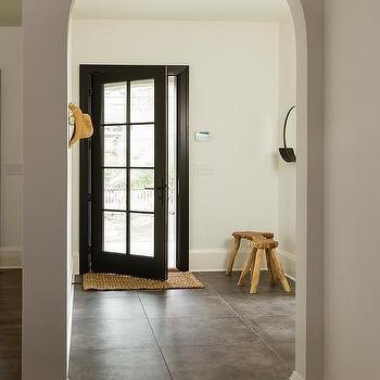 Black Glass Panel Front Door With Concrete Gray Tiles