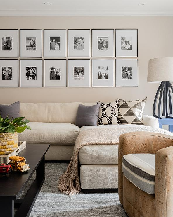 A Black And White Photo Gallery Is Mounted To A Cream Wall Above A Long Cream  Sofa With A Chaise Lounge. Part 37
