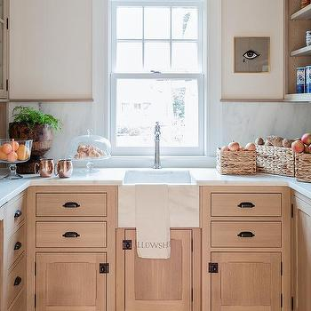 Charming Light Wood Kitchen Pantry Cabinets With Bronze Cup Pulls