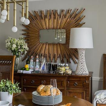 Rectangular Gold Sunburst Mirror Over Antique Buffet Cabinet