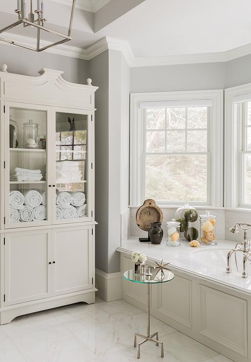 Bay window with wainscoted bathtub transitional bathroom for Bay window bathroom ideas