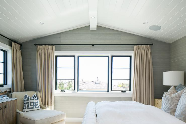 White And Tan Bedroom With A Vaulted Shiplap Ceiling Accented By Gray  Grasscloth Wallpaper Features A Tan Chaise Lounge In The Corner.
