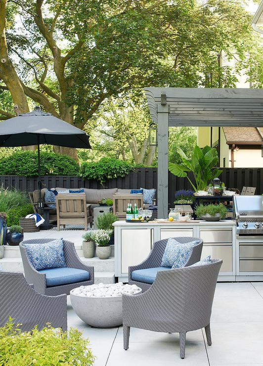 Modern Gray Chairs With Round Concrete Fire Pit