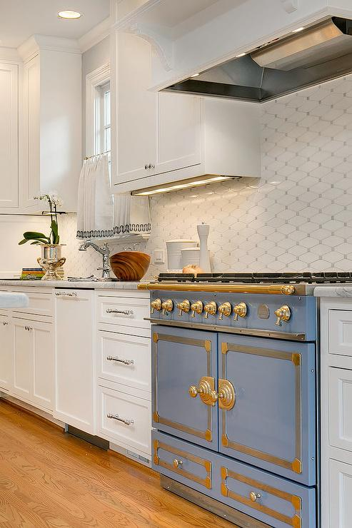 Blue Stove With White And Gray Diamond Tiles