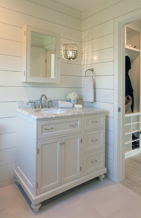 Gray Beaded Wall Sconce On Shiplap Bathroom Walls
